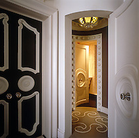 Elaborate curved doors open onto a circular hall with a patterned carpet