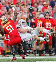 Ohio State Buckeyes tight end Jeff Heuerman (5) holds onto the ball for a reception despite interference called on Maryland Terrapins linebacker Yannik Cudjoe-Virgil (51) in second half action at Byrd Stadium on October 4, 2014.  (Chris Russell/Dispatch Photo)