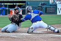 Round Rock catcher Tomas Telis (6) tags out Nashville Sounds third baseman Ryan Roberts (19) at the home plate, Saturday May 02, 2015 in Round Rock, Tex. Express defeated Sounds 5-4. (Mo Khursheed/TFV Media via AP images)