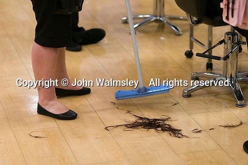 Student sweeping up in the Arena Salon, Hair & Beauty Dept., Kingston College.
