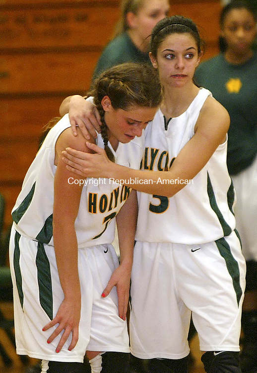 WATERBURY, CT, 12/30/08- 123008BZ05-  Holy Cross' Devon Diliberto (23) is comforted by Cara Rinaldi (3) after their 56-51 loss to Kennedy Tuesday night.  Kennedy's victory snaps Cross' 86 game NVL consecutive win streak.<br />  Jamison C. Bazinet Republican-American