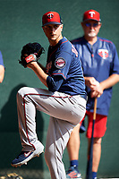 Minnesota Twins pitcher Jake Odorizzi (12) throws in the bullpen as Bert Blyleven looks on during a Spring Training practice on February 22, 2019 at Hammond Stadium in Fort Myers, Florida.  (Mike Janes/Four Seam Images)
