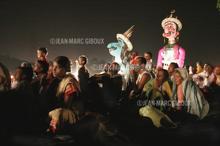 .RAMNAGAR, UTTAR PRADESH, INDIA - OCTOBER 5, 2005 : Villagers and pilgrims watch the night performance of the Ramlila, surrounded by giant effigies of demons on October 5, 2005. The Ramlila is the play of the Hindu scripture 'the Ramayana', translated into Sanskrit by Tulsidas in Varanasi 500 years ago, which depict the adventures of the god Ram and his flight against the Demon God Ravana. The Ramlila of Ramnagar has been organized by the Maharaja of Benares since the early 1800s and is still the most authentic, a reference to other Ramlilas. It last for 31 days over a 10 square mile area and It is still the largest theatre production in the world .(Photo by Jean-Marc Giboux)