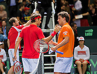 Switserland, Genève, September 18, 2015, Tennis,   Davis Cup, Switserland-Netherlands, Jesse Huta Galung (NED) (R) congratulates Roger Federer with his win<br /> Photo: Tennisimages/Henk Koster