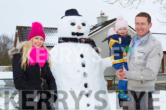 Denise, Georgie and Aidan O'Callaghan Castleisland with their snow man on Friday