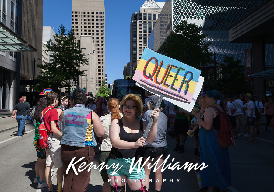 Woman holding Queer sign, Seattle Pride Parade 2016, Washington, USA.