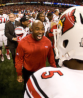 Louisville head coach Charlie Strong celebrates with quarterback Teddy Bridgewater after winning 79th Sugar Bowl game against Florida at Mercedes-Benz Superdome in New Orleans, Louisiana on January 2nd, 2013.   Louisville Cardinals defeated Florida Gators, 33-23.