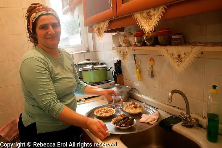 Kurdish woman in her kitchen, Istanbul, Turkey