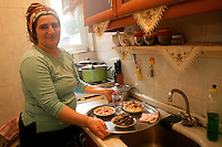 Kurdish woman in her kitchen, Istanbul, Turkey