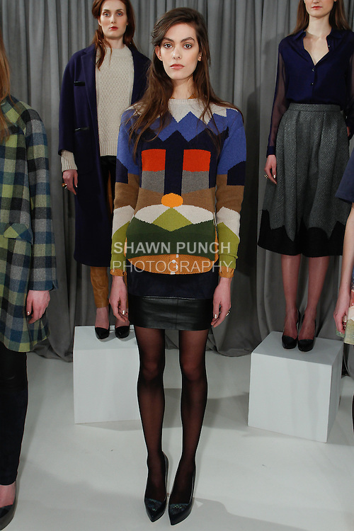 Model poses in an outfit from the Novis Autumn Winter 2014 collection by Jordana Warmflash, during New York Fashion Week Fall 2014, on February 7, 2014.