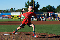 Batavia Muckdogs youth camp participant throws out a ceremonial first pitch before a game against the Lowell Spinners on August 12, 2015 at Dwyer Stadium in Batavia, New York.  Batavia defeated Lowell 6-4.  (Mike Janes/Four Seam Images)