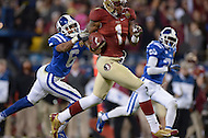 December 7, 2013  (Charlotte, North Carolina)  Florida State Seminoles wide receiver Kelvin Benjamin #1 runs the ball as Duke Blue Devils cornerback Ross Cockrell #6 attempts a tackle in the 2013 ACC Championship game. (Photo by Don Baxter/Media Images International)