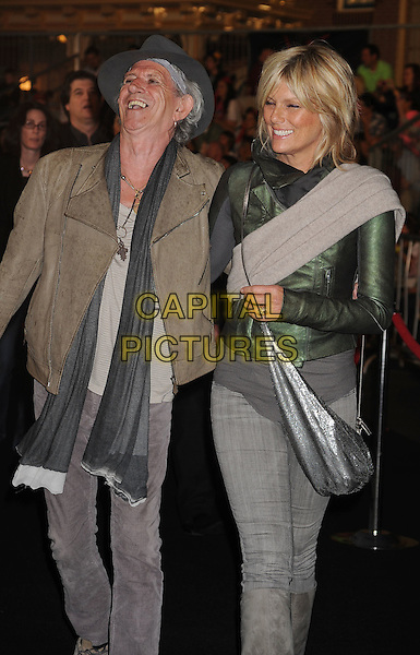 "KEITH RICHARDS & PATTI HANSEN.Premiere of ""Pirates of the Caribbean : On Stranger Tides"" held at Disneyland in Anaheim, California, USA, May 7th 2011.4 four full half 3/4 length grey gray hat scarf leather jacket green cream beige  married husband wife smiling laughing .CAP/ROT/TM.© TM/Roth/Capital Pictures"