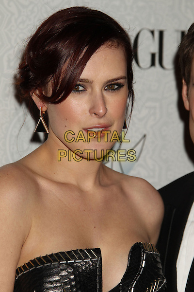 RUMER WILLIS .Attending The Art of Elysium's 3rd Annual Black Tie Charity Gala Heaven at the Beverly Hilton, Beverly Hills, CA, USA, January 16th 2010. .arrivals portrait headshot hair up black earrings triangle  strapless leather stitched stitching  snake embossed .CAP/ADM/MJ.©Michael Jade/Admedia/Capital Pictures