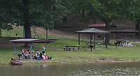 NWA Democrat-Gazette/J.T. WAMPLER A family picnics at Beaver Lake Friday May 26, 2017 at the Prairie Creek Recreation Area & Campground near Rogers. More Americans are expected to travel this holiday weekend since 2005 and Arkansas state park campgrounds were nearing capacity as of Friday afternoon.