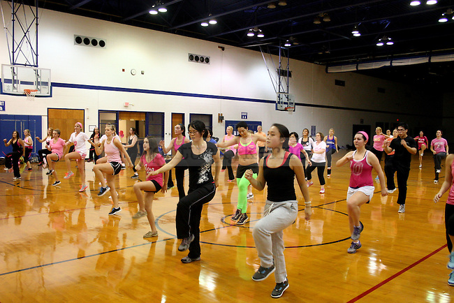 Participants in the 2012 Susan G. Komen Party in Pink dance to zumba, a popular aerobic dance, in the Seaton Center Gym at UK  in Lexington, Ky., on Sunday, October 28, 2012. Photo by Adam Pennavaria | Staff