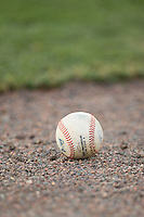 An International League baseball lies on the warning track between innings of the game between the Indianapolis Indians and the Charlotte Knights at BB&T BallPark on June 20, 2015 in Charlotte, North Carolina.  The Knights defeated the Indians 6-5 in 12 innings.  (Brian Westerholt/Four Seam Images)