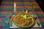 Braised wild hare in mustard cream sauce with rice pilaf