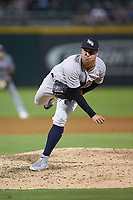 Scranton/Wilkes-Barre RailRiders relief pitcher J.P. Feyereisen (18) follows through on his delivery against the Charlotte Knights at BB&T BallPark on August 14, 2019 in Charlotte, North Carolina. The Knights defeated the RailRiders 13-12 in ten innings. (Brian Westerholt/Four Seam Images)