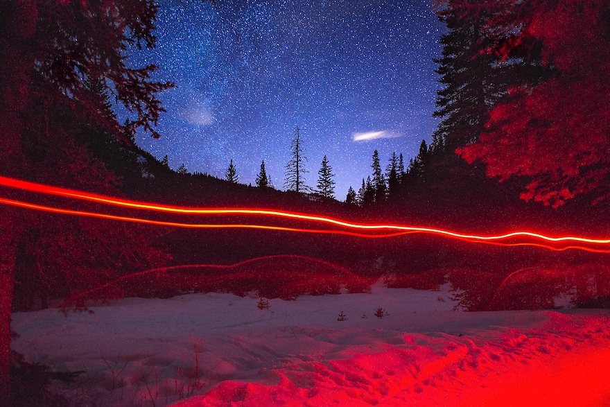 Light trails from skiers' headlamps pass beneath a starry ski in Hyalite Canyon south of Bozeman.