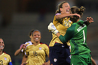 United States' Abby Wambach and Lindsey Barnhart celebrating the championship, during game of the Womens Preolympic soccer tournament held at Ciudad Juarez. Mexico