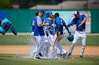 Dunedin Blue Jays Kacy Clemens (21) is doused with water in celebration after hitting a game winning single to score Ryan Noda (not shown) during a Florida State League game against the Jupiter Hammerheads on May 16, 2019 at Jack Russell Memorial Stadium in Clearwater, Florida.  Dunedin defeated Jupiter 1-0.  (Mike Janes/Four Seam Images)