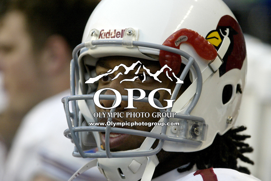 26 Dec 2004:Arizona Cardinals wide receiver Larry Fitzgerald takes a breather on the sidelines while the defense was on the field against the Seattle Seahawks in Seattle, WA.