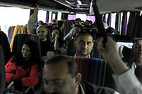"""Members of the Roma or gypsy theater Romathan ride in a bus on their way to perform for young children in """"Dwarf"""" at the Banske Elementary School with a Roma or gypsy majority student body in Banske, Slovakia on June 2, 2010."""