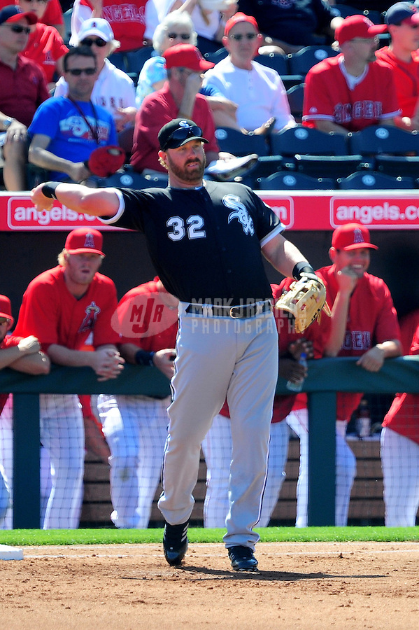 Mar. 6, 2012; Tempe, AZ, USA; Chicago White Sox first baseman Adam Dunn fields a ball in the first inning against the Los Angeles Angels during a spring training game at Tempe Diablo Stadium.  Mandatory Credit: Mark J. Rebilas-