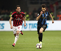 Calcio, Serie A: AC Milan - Inter Milan, Giuseppe Meazza (San Siro) stadium, Milan on 17 March 2019.  <br /> Inter's Antonio Candreva (r) in action with Milan's Hakan Calhanoglu (l) during the Italian Serie A football match between Milan and Inter Milan at Giuseppe Meazza stadium, on 17 March 2019. <br /> UPDATE IMAGES PRESS/Isabella Bonotto