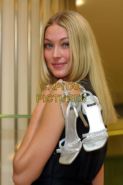 HEIDI WICHLINSKI.Stuart Weltzman's $1million diamond & platinum shoes go on sale at Harrods today, guarded by a round the clock security guard. .half length, half-length, sandals, diamonds.www.capitalpictures.com.sales@capitalpictures.com.© Capital Pictures.
