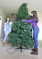 (L-R) Grace Shafer and Laura Quintero assemble Christmas Trees at Magnolia Springs Bridgewater, an assisted living community in Carmel.