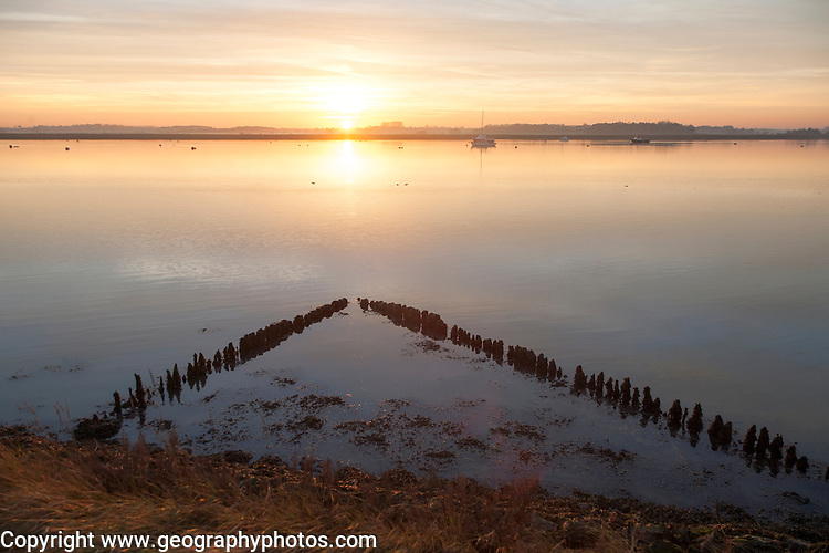 Winter landscape at sunset on the River Deben, Ramsholt, Suffolk, England