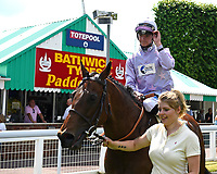 Edged Out ridden by Mitch Goodwin is led into the winners enclosure after winning The Think Cars Ssangyong Paddock Area Display Handicap during Father's Day Racing at Salisbury Racecourse on 18th June 2017