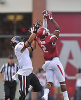 NWA Democrat-Gazette/MICHAEL WOODS • @NWAMICHAELW<br /> Arkansas defender DJ Dean goes up for an interception in front of Texas Tech receiver Justin Stockton in the 1st quarter of Saturday nights game at Razorback Stadium in Fayetteville.