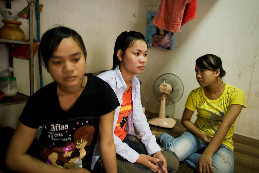 Sun Seaklay (L) and Kong Kunthea (C), both 22, have been garment factory workers for four years, Phnom Penh, Cambodia, September 8, 2010.