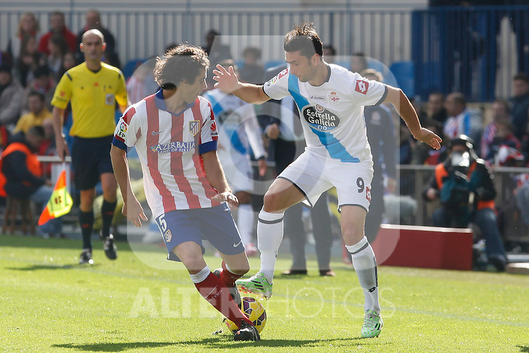 Atletico de Madrid´s Tiago Cardoso (L) and Deportivo de la Coruña´s Helder during 2014-15 La Liga match between Atletico de Madrid and Deportivo de la Coruña at Vicente Calderon stadium in Madrid, Spain. November 30, 2014. (ALTERPHOTOS/Victor Blanco)