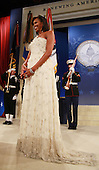 Washington, DC - January 20, 2009 -- United States Michelle Obama listens to her husband, Preisdent Barack Obama, speak at the Obama Homes States Ball, one of ten official inaugural balls January 20, 2009 in Washington DC.  Obama was sworn in as the 44th President of the United States today, becoming the first African-American to be elected to the presidency.  .Credit: Mark Wilson - Pool via CNP