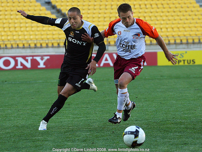 Leo Bertos and Andrew Packer chase a ball into the box during the A-League football match between the Wellington Phoenix and Queensland Roar at Westpac Stadium, Wellington. Sunday, 26 October 2008. Photo: Dave Lintott / lintottphoto.co.nz