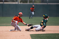 San Francisco Giants Orange second baseman Hector Santiago (43) prepares to apply the tag to an Athletics baserunner on a stolen base attempt during an Extended Spring Training game against the Oakland Athletics at the Lew Wolff Training Complex on May 29, 2018 in Mesa, Arizona. (Zachary Lucy/Four Seam Images)