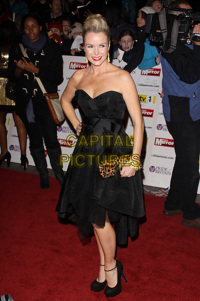 AMANDA HOLDEN.The Pride of Britain Awards 2010, Grosvenor House, Park Lane, London, England, UK..November 8th 2010.arrivals full length strapless black dress clutch bag leopard print animal shoes platform tulle ankle strap gold bracelet .CAP/AH.©Adam Houghton/Capital Pictures.