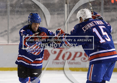 Mike Hurlbut (2) and Randy Cunneyworth (15) celebrate a goal during The Frozen Frontier Buffalo Sabres vs. Rochester Amerks Alumni Game at Frontier Field on December 15, 2013 in Rochester, New York.  (Copyright Mike Janes Photography)