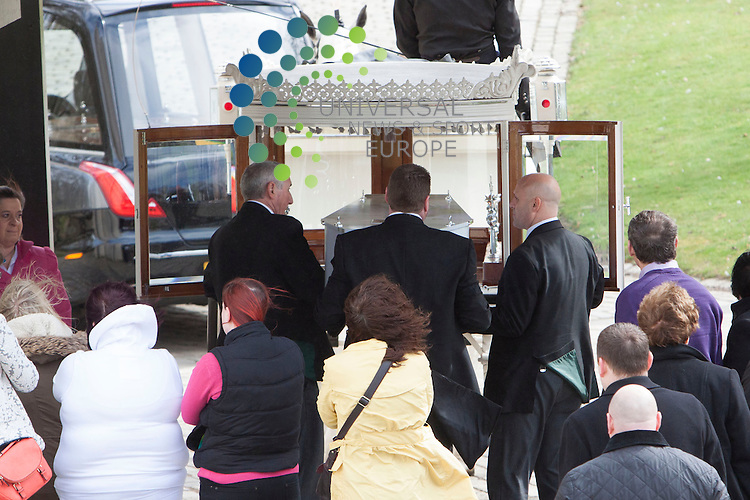 The funeral of 12-year-old Keane Wallis-Bennett  who died after a wall fell on her at an Edinburgh school.<br /> Keane Wallis-Bennett was fatally hurt when a free-standing wall collapsed on her at Liberton High School on 1 April.<br /> Her friends wore onesies to her funeral at the city's Mortonhall Crematorium.<br /> Her family has asked mourners to wear bright colours at the service.<br /> The school is due to open on 22 April following the Easter break.<br /> Picture: Duncan McGlynn/Universal News And Sport (Scotland) 17/04/2014.