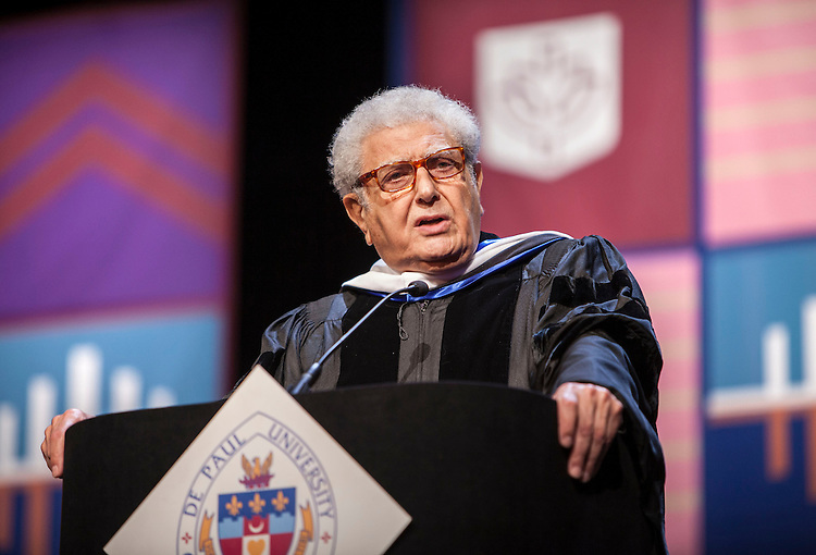 M. Cherif Bassiouni, DePaul emeritus professor of law and honorary degree recipient, offers an address as the DePaul University College of Law held its commencement ceremony on May 17, 2015 at the Rosemont Theatre in Rosemont, IL, where some 280 students received their Juris Doctors or Master of Laws degrees. The Rev. Dennis H. Holtschneider, C.M., president of DePaul, conferred the degrees. (DePaul University/Jeff Carrion)
