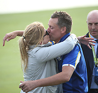Ian Poulter (Team Europe) kissing his wife during Sunday's Singles, at the Ryder Cup, Le Golf National, Île-de-France, France. 30/09/2018.<br /> Picture David Lloyd / Golffile.ie<br /> <br /> All photo usage must carry mandatory copyright credit (© Golffile | David Lloyd)
