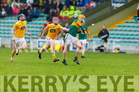 Kerrys Michael O'Leary attempts get his efforts way as Eoghan Campbell of Antrim is about to hook him, in the NHL Div 2A hurling game in Austin Stack Park on Sunday