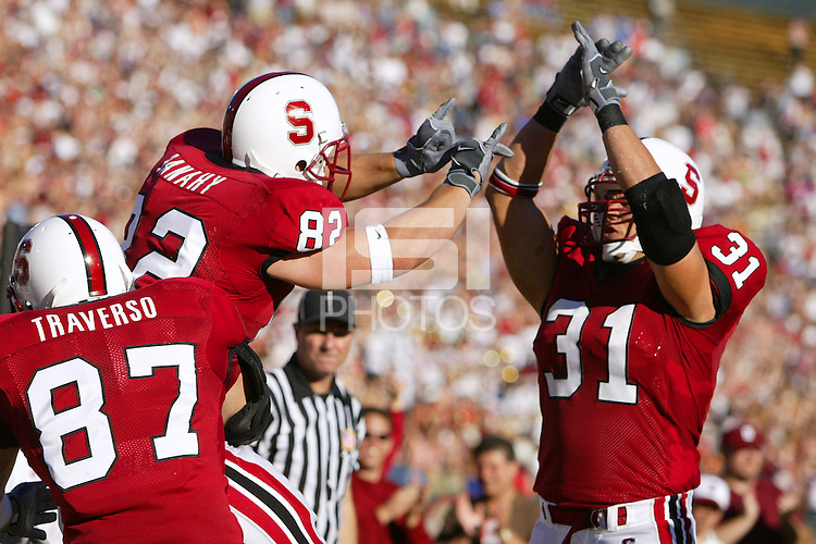 25 September 2004: Kris Bonifas, Patrick Danahy, and Matt Traverso during Stanford's 31-28 loss to the USC Trojans on September 25, 2004 at Stanford Stadium in Stanford, CA.