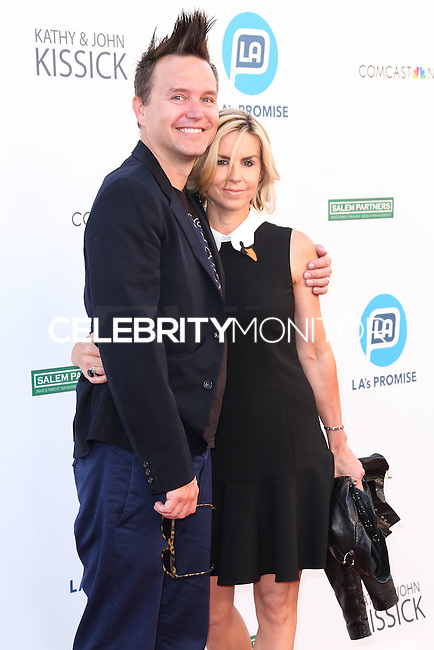 UNIVERSAL CITY, CA, USA - SEPTEMBER 30: Mark Hoppus, Skye Everly arrive at LA's Promise Gala 2014 held at the Globe Theatre at Universal Studios on September 30, 2014 in Universal City, California, United States. (Photo by Xavier Collin/Celebrity Monitor)
