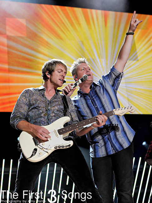 Joe Don Rooney and Gary LeVox of Rascal Flatts perform at LP Field during the 2011 CMA Music Festival on June 11, 2011 in Nashville, Tennessee.