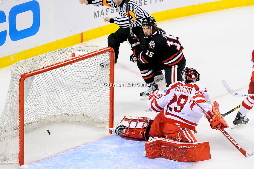 Northeastern University Huskies forward Kevin Roy (15) scores on Boston University Terriers goalie Matt O'Connor (29) during the first semi-final Beanpot Tournament hockey game between Boston University and Northeastern University held at TD Garden in Boston Massachusetts.  Eric Canha/CSM